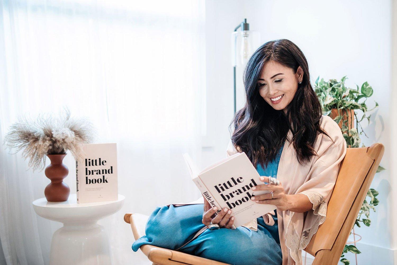 Kalika Yap reading little brand book